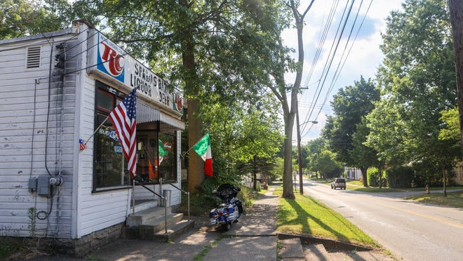 Ravenna City Council is considering legislation to ban on-street parking on Highland Avenue. Spano's Bar, pictured at left, sits along Highland Avenue, looking west toward Diamond Street in Ravenna.