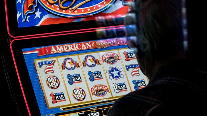 A man plays a video slot machine in a lounge at Huck's, a truck stop in Mount Vernon, Illinois. Republicans in Pennsylvania's state Senate are pressing gambling legislation that would allow slot machine-like terminals in thousands of the state's bars, restaurants and more.