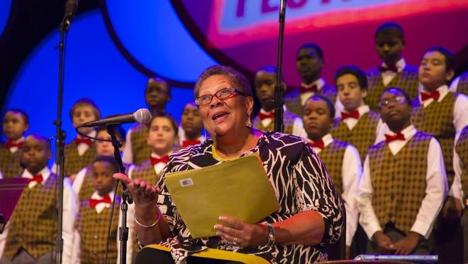 Poet Marilyn Nelson with the Newark Boys Chorus, pictured at the 2014 Geraldine R. Dodge Poetry Festival in Newark.