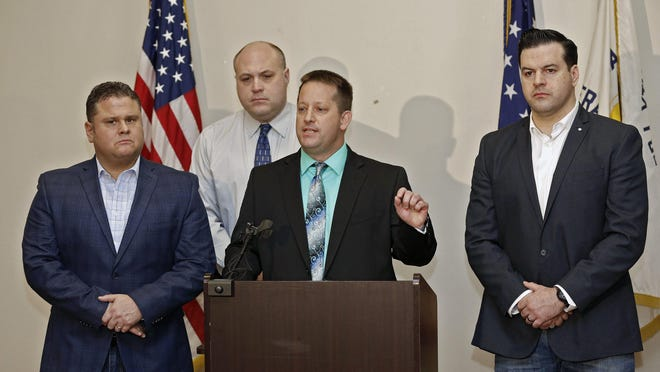 Keith Ferrell, president of Fraternal Order of Police Lodge No. 9, which represents some 1,900 Columbus Division of Police members from officers to commanders, speaks during a news conference in 2018 while he was the union's executive vice president. [Kyle Robertson/Dispatch photo]