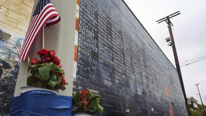This Monday, May 30, 2016, file photo shows flowers left next to a vandalized Vietnam War memorial in the Venice area of Los Angeles. The Associated Press this week reported on stories and photos online incorrectly identified as the Vietnam Veterans Memorial in Washington, D.C., marred by graffiti as a result of riots after the death of George Floyd. The photos circulating on social media are from 2016 and show this Vietnam Veterans Memorial replica in Los Angeles, which was defaced in that year.