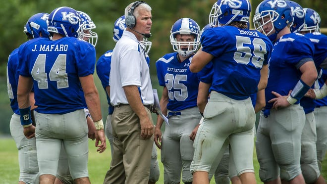 Kittatinny head coach Joe Coltelli huddles with his team during their game against Wallkill Valley on Sept. 14, 2019, at Wallkill Valley High School.