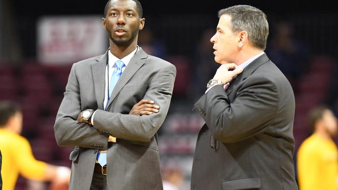 "East Stroudsburg University men's basketball assistant coach Muhamadou Kaba, left, was named to the Silver Waves Media ""50 Impactful Division II Assistants"" list earlier this week."