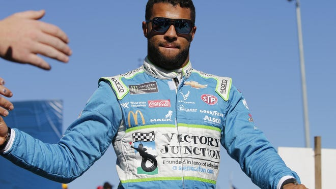 Bubba Wallace greets fans during the NASCAR Cup Series race at Martinsville Speedway in Martinsville, Va., Sunday, Oct. 27, 2019.