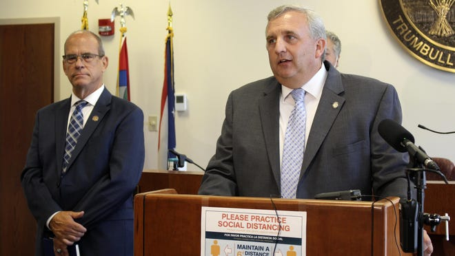 State Reps. Gil Blair, D-Weathersfield, right, and Michael O'Brien, D-Warren, attend a news conference with state Sen. Sean O'Brien, D-Bazetta, not shown, Wednesday, July 22, 2020 in Warren, Ohio. The three are calling for the immediate repeal of the nuclear plant bailout law at the center of a bribery scandal surrounding Republican Ohio House Speaker Larry Householder.