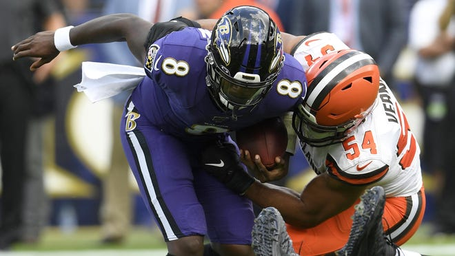 Browns defensive end Olivier Vernon sacks Baltimore Ravens quarterback Lamar Jackson during a game last season in Baltimore.
