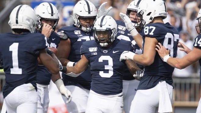Penn State running back Ricky Slade (3) celebrates his first-quarter touchdown against Idaho in a NCAA college football game in State College, Pa., on Saturday, Aug. 31, 2019.
