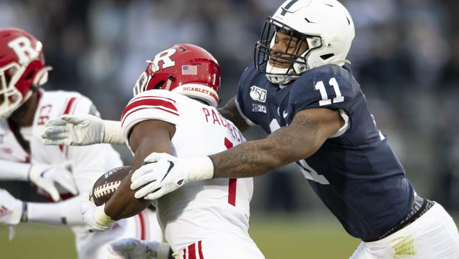 FILE - In this Nov. 30, 2019, file photo, Penn State linebacker Micah Parsons (11) tackles Rutgers tight end Johnathan Lewis (11) in the first quarter of an NCAA college football game, in State College, Pa. Penn State All-American Micah Parsons is opting out of the 2020 season because of concerns about COVID-19. The junior linebacker made his announcement with a social media post Thursday.