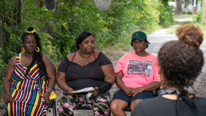 From left, Brandon Smith's mother, Paula Davis, and sisters Georgia and Crystal Davis, talk to Lily Nicole (back to camera) and Lighthouse Films on Saturday, June 6, 2020. Smith was killed by police in Wilmington in 2013 and his family has called for the case to be re-opened.
