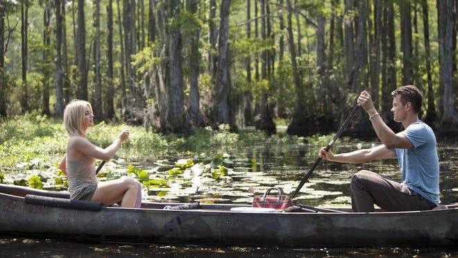 "Julianne Hough and Josh Duhamel in a scene from ""Safe Haven"" that was filmed in Pleasant Oaks Plantation in Brunswick County."
