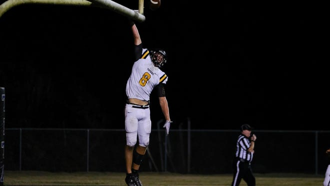 Gavin Ellis celebrates after scoring a touchdown for Topsail last year. Ellis was recently offered a scholarship to play football at Wake Forest.