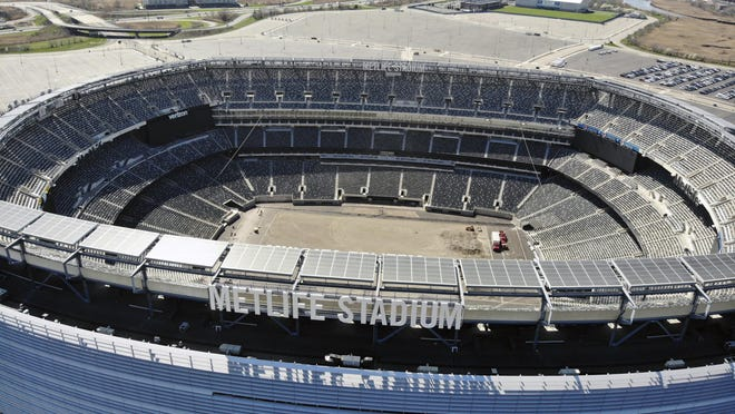 An empty MetLife Stadium in East Rutherford, New Jersey, is seen from the air in April. Even if there are no fans in the stands, the NFL's television deals will keep it profitable.