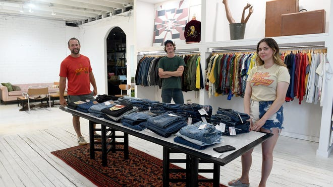 Adam Hoover, Evan Rutledge and Magan Mclaughlin at Lost Thread Vintage clothing store inside Main Street Modern in Canton.