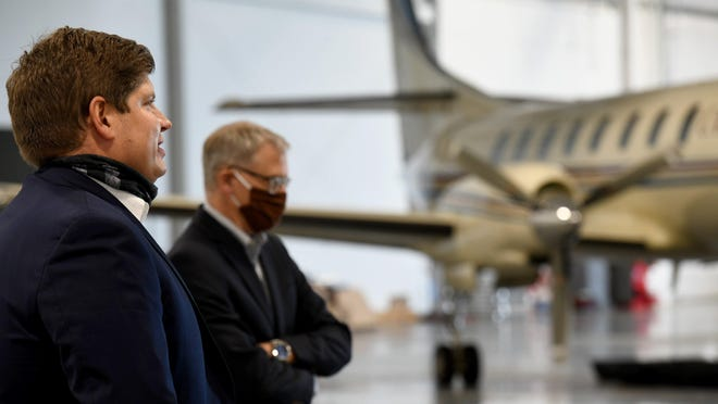 Mike Grossman, owner of Castle Aviation in Green, on Tuesday welcomed Robert Scott, left, Small Business Administration regional administrator for the Great Lakes Region, and Ralph Lober, CEO of Consumers National Bank (in back), for a tour.