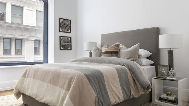 A mix of rose and charcoal gray creates an interesting color mix in this bedroom.