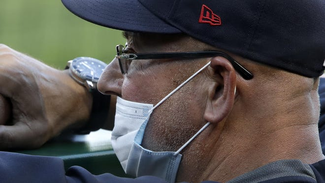 Indians manager Terry Francona stands in the dugout during an exhibition  game against the Pittsburgh Pirates last  month.