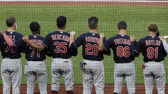 Members of the Cleveland Indians line up for the national anthem before an exhibition baseball game against the Pittsburgh Pirates in Pittsburgh, Saturday, July 18, 2020.