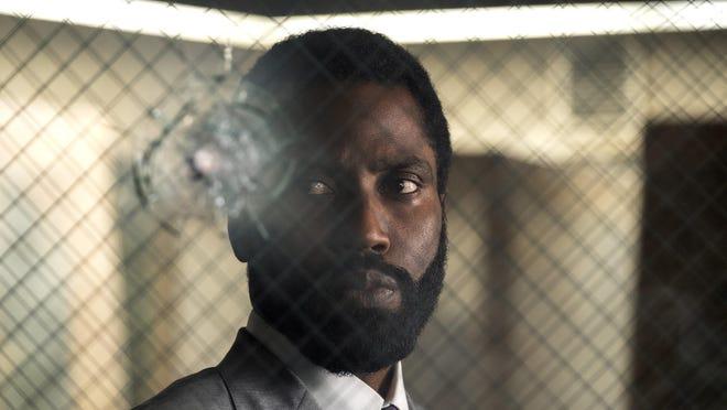 "John David Washington stars in ""Tenet,""  director Christopher Nolan's much-anticipated $200 million thriller."