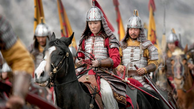 "Yifei Liu, center, in the title role of ""Mulan."""
