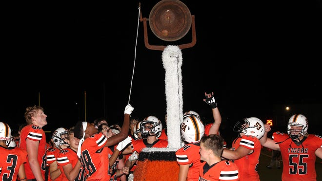 The Kirksville football team rings the bell following Friday's win over Chillicothe.