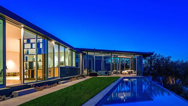 The dramatic Hollywood Hills home of musician Pharrell Williams was designed by Hagy Belzberg and completed in 2007. Set atop a ridge, the modern showplace features an open-concept floor plan, walls of glass and a minimalist-vibe kitchen.