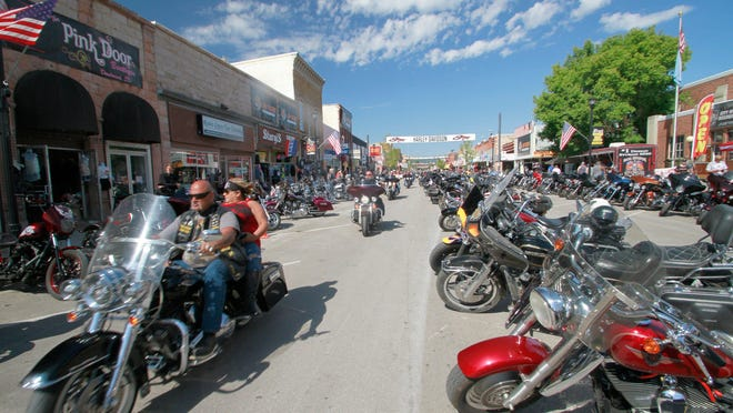 Thousands of bikers rode through the streets for the opening day of the 80th annual Sturgis Motorcycle rally Friday, Aug. 7, 2020, in Sturgis, S.D.