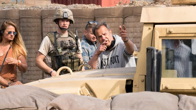 "Rod Lurie sets up a shot on the set of ""The Outpost."""