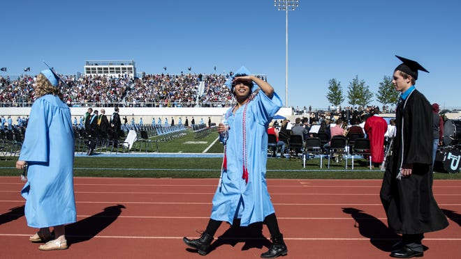 Students look for their families as they head to their seats at the start of the Pueblo West Graduation Ceremony in 2019. This year's commencement will take place at 8 a.m. June 12 at Pueblo West High School.