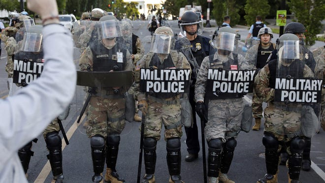 National Guard military police officers block demonstrators during a protest against the death of George Floyd, near the White House in Washington, D.C., on June 1.