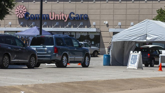 Coronavirus testing site at CommUnityCare in central Austin with more than 25 cars in line, Thursday, June 11, 2020.