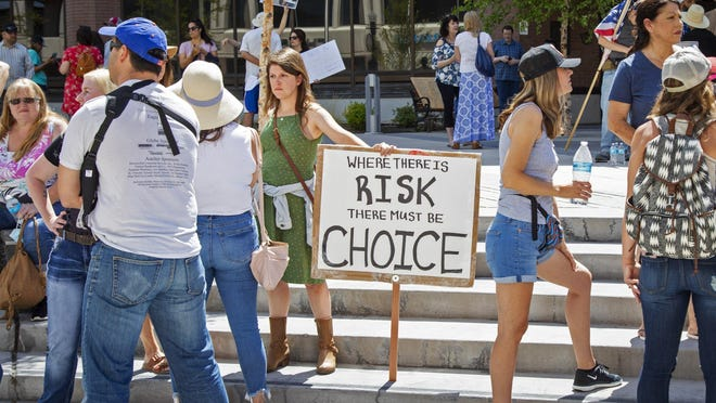 Demonstrators gather at Boise, Idaho City Hall to protest the mayor's order mandating people to wear face coverings on July 3.