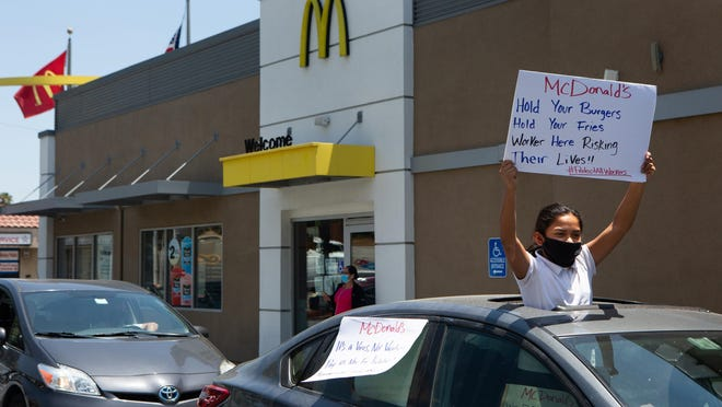 A protest in support of McDonald's workers at a drive-thru in Monterey Park, California, on May 20, 2020.
