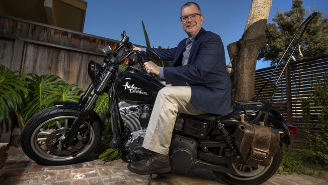 RespectAbility Lab Co-founder Delbert Whetter is photographed with his Harley Davidson motorcycle on Aug. 14, 2020 in front of his home in Santa Monica, California.