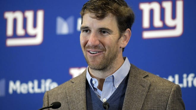 FILE - In this Dec. 2, 2018, file photo, New York Giants quarterback Eli Manning talks to reporters after an NFL football game against the Chicago Bears, in East Rutherford, N.J. Eli Manning has won the Pro Football Writers of America's Good Guy Award for his cooperation with the media. Manning, who retired after the 2019 season, has been lauded for years for his dealings with local and national media.