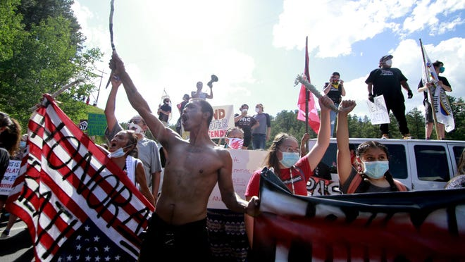 Native American protesters form a roadblock on the road leading to Mount Rushmore ahead of President Donald Trump's visit to the memorial on Friday, July 3, 2020, in Keystone, S.D.