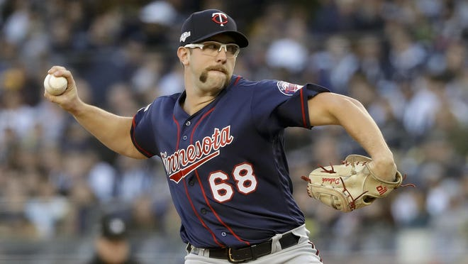 "Twins pitcher Randy Dobnak, shown in a 2019 playoff game against the New York Yankees, says: ""We're all ready to get back, because baseball's literally been our lives for our whole entire lives."""