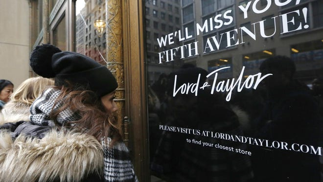 Women peer in the front door of Lord & Taylor's flagship Fifth Avenue store which closed for good, Wednesday, Jan. 2, 2019, in New York. After 104 years, the104-year old retail store locked its doors forever. The venerable department store famed for its animated holiday windows ended a blowout sale mid-afternoon Wednesday that left whole floors empty. By the end, clothes that once sold for as much as $100 were going for $5.99.