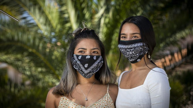 """Donalene Ferrer, left, who is of Filipino ancestry, and her daughter, Charlie, 17, who is Filipino-Italian, were walking with Donalene's mother in Oceanside, Calif., when the mother's neighbor yelled at them: """"You started the corona."""" The pandemic's Chinese genesis and other factors have caused an unprecedented spike in hatred toward Asians and Asian Americans, Clifford Chiu writes."""