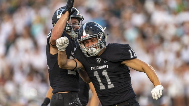 Vandegrift defensive back Kaleb Lewis celebrates an interception against Cedar Park last season with defensive back Logan Arnold. The pair returns for one of the top secondaries in the Austin area.