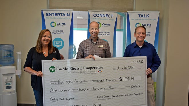 Co-Mo employees Dawn Walls, Member Care Representative, and Aaron Bradshaw, Co-Mo CEO, present a check June 18 to Darren White, Regional Manager of the Food Bank for Central and Northeast Missouri.