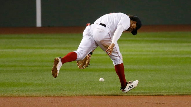 Boston Red Sox shortstop Xander Bogaerts (2) can't get to a ground ball single by Atlanta Braves second baseman Johan Camargo (17) during the eighth inning of a baseball game, Tuesday, Sept. 1, 2020, in Boston.
