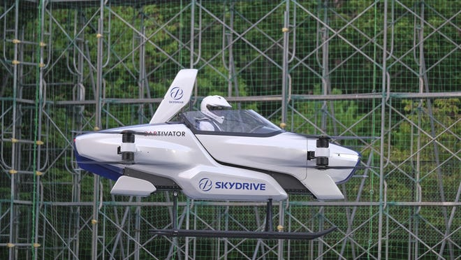 """This photo taken at the beginning of August, 2020 shows a test flight of a manned '""""flying car"""" at Toyota Test Field in Toyota, central Japan. Japan's SkyDrive Inc., among many similar projects around the world, has carried out a successful though modest test flight with one person aboard."""