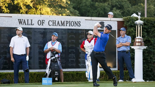 Brian Harman plays a shot from the first tee as he, Bill Haas, left, and Ryan Palmer make up the first group to tee off for the initial round of the Charles Schwab Challenge golf tournament Thursday at Colonial Country Club in Fort Worth, Texas.