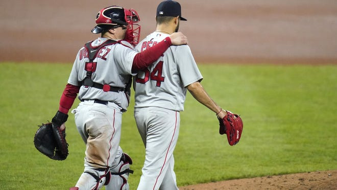 If Boston Red Sox catcher Christian Vazquez and Martin Perez (54) were hoping to get a heaping pile of wings Monday in Buffalo, they'll have to wait. The Sox aren't flying out of Baltimore until Monday night before the team takes on the Toronto Blue Jays Tuesday.