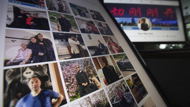 """Facebook pages from Guo Wengui's account are seen on computer screens in Beijing on Friday, Aug. 21, 2020. The self-exiled Chinese tycoon on whose 150-foot (45-meter) yacht President Donald Trump's former chief strategist, Steve Bannon, was arrested is a high-profile irritant to the ruling Communist Party. In June, Guo and Bannon announced the founding of the """"Federal State of New China,"""" an initiative to """"overthrow the Chinese government."""""""