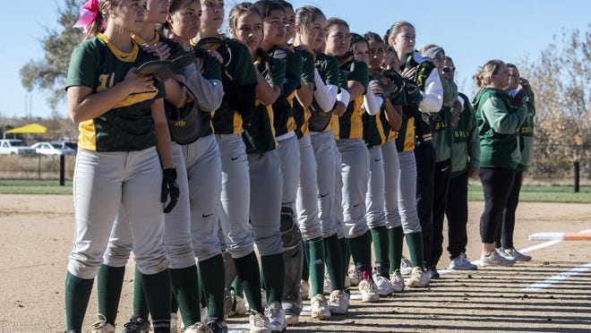 The Pueblo County softball team lines up for the national anthem before the start of its Class 4A state tournament first round matchup against Roosevelt on Oct. 25, 2019, at the Aurora Sports Park.