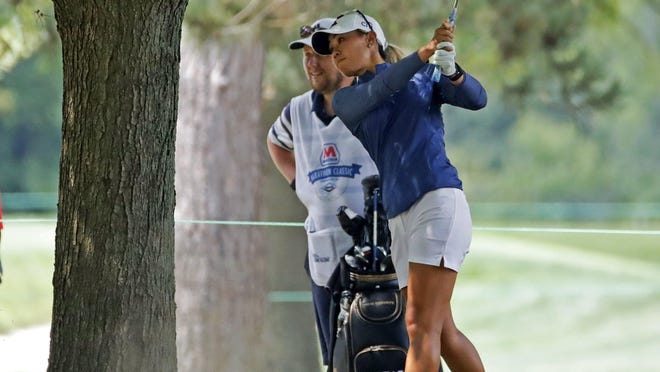 Danielle Kang hits from under a tree Sunday on the fifth fairway during the final round of the Marathon Classic.
