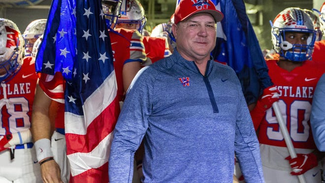 Westlake head coach Todd Dodge prepares to take the field with his team before the Class 6A Division II football championship game against Denton Guyer in December in Arlington. Dodge led his team to the win and the program's second state title.