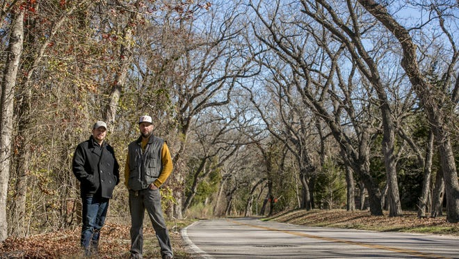 Bradley Taylor, left, and Brian Ender are renewing their efforts to save trees along Hairy Man Road in Round Rock from a city road extension project. They first banded together to protect the trees last winter when they were threatened by a county road project.