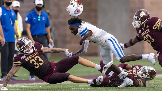 SMU wide receiver Danny Gray is tackled by, from left, Texas State linebacker Brayden Stringer, safety Zion Childress and defensive end Derrick Ray in Saturday's season opener. SMU won 31-24.
